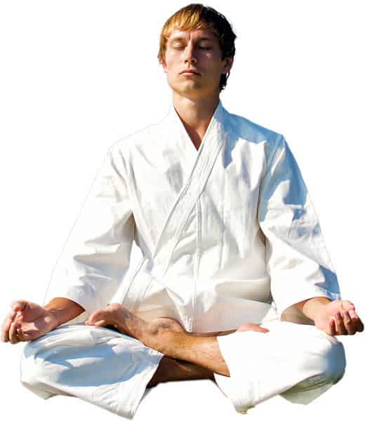 Martial Arts Lessons for Adults in North Richland Hills TX - Young Man Thinking and Meditating in White