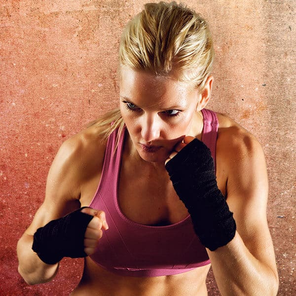 Mixed Martial Arts Lessons for Adults in North Richland Hills TX - Lady Kickboxing Focused Background