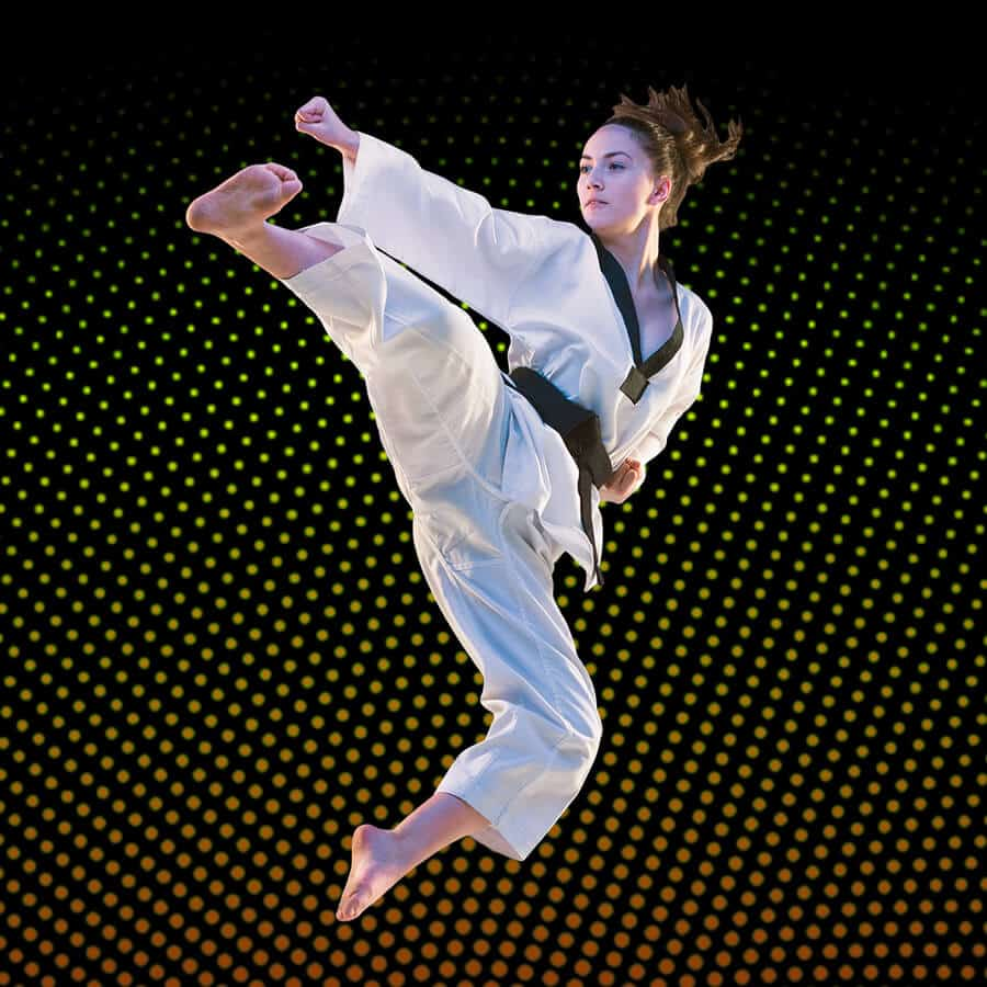 Martial Arts Lessons for Adults in North Richland Hills TX - Girl Black Belt Jumping High Kick