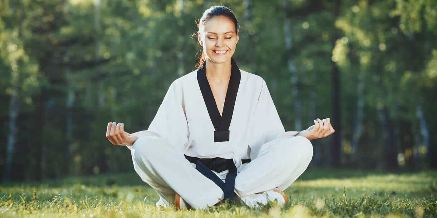 Martial Arts Lessons for Adults in North Richland Hills TX - Happy Woman Meditated Sitting Background