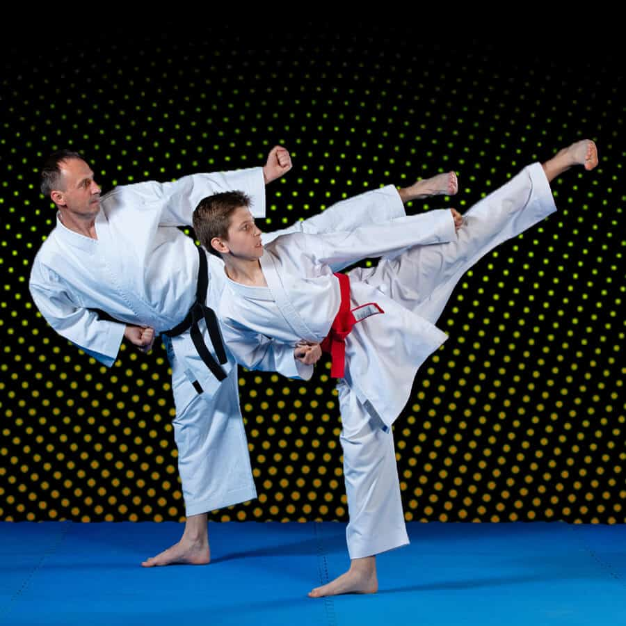 Martial Arts Lessons for Families in North Richland Hills TX - Dad and Son High Kick