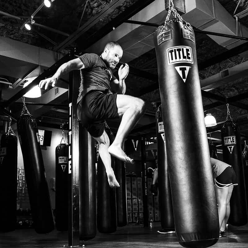 Mixed Martial Arts Lessons for Adults in North Richland Hills TX - Flying Knee Black and White MMA